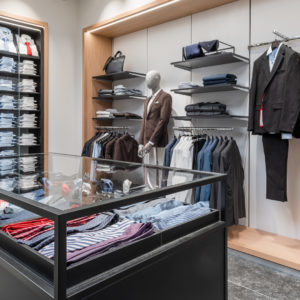 """ROL Fredbergs would like to proudly present one of our latest projects that we have undertaken for Hugo Boss. Hugo Boss has now moved back to newly renovated premises at the Hede Fashion outlet. Hugo Boss, renowned for its timeless designs, premium quality and meticulous attention to detail and it epitomizes authentic, understated luxury. Founded by German tailor Hugo Ferdinand Boss in 1924, the men's collection offers razor-sharp tailoring along with refined casual options, while BOSS Womenswear stands for feminine styles with a strong focus on fine fabrics and subtle detailing.  At the Hede Fashion Outlet in Kungsbacka, just 25 minutes south of Gothenburg, you will find over 150 popular Scandinavian and international fashion and lifestyle brands in a convenient location. Hede Fashion Outlet's premium profile has a wide mix of quality brands which attracts a plethora of discerning customers.  With its inauguration in October this year the Hede Fashion Outlet now has a total of 70 stores, food concepts and playground. All on a total area of 19,000 square meters. A venture that has generated 100 new jobs for the local area. ROL Fredbergs has been responsible for dismantling the old Hugo Boss store, building a temporary store, and then performing a total renovation of the shop area and installing a new interior design concept. The ROL Fredbergs project manager for the construction project is Anders Jonasson. Anders says that the renovation project has been going on for six weeks. Over this period of time we have delivered new flooring, demolished and built new walls, installed new electrics, painted, fluttered, installed new lighting, installed new interior design, installed checkout system, installed internal and external communication. We have actually done everything necessary to hand over a turn-key shop for Hugo Boss. """"It has been a very exciting and fun project"""", says Anders. """"Since the client's Operations team works in England, this could have been be a major c"""