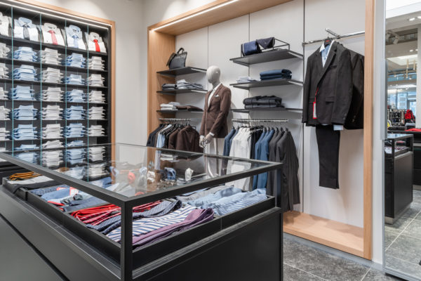 "ROL Fredbergs would like to proudly present one of our latest projects that we have undertaken for Hugo Boss. Hugo Boss has now moved back to newly renovated premises at the Hede Fashion outlet. Hugo Boss, renowned for its timeless designs, premium quality and meticulous attention to detail and it epitomizes authentic, understated luxury. Founded by German tailor Hugo Ferdinand Boss in 1924, the men's collection offers razor-sharp tailoring along with refined casual options, while BOSS Womenswear stands for feminine styles with a strong focus on fine fabrics and subtle detailing.  At the Hede Fashion Outlet in Kungsbacka, just 25 minutes south of Gothenburg, you will find over 150 popular Scandinavian and international fashion and lifestyle brands in a convenient location. Hede Fashion Outlet's premium profile has a wide mix of quality brands which attracts a plethora of discerning customers.  With its inauguration in October this year the Hede Fashion Outlet now has a total of 70 stores, food concepts and playground. All on a total area of ​​19,000 square meters. A venture that has generated 100 new jobs for the local area. ROL Fredbergs has been responsible for dismantling the old Hugo Boss store, building a temporary store, and then performing a total renovation of the shop area and installing a new interior design concept. The ROL Fredbergs project manager for the construction project is Anders Jonasson. Anders says that the renovation project has been going on for six weeks. Over this period of time we have delivered new flooring, demolished and built new walls, installed new electrics, painted, fluttered, installed new lighting, installed new interior design, installed checkout system, installed internal and external communication. We have actually done everything necessary to hand over a turn-key shop for Hugo Boss. ""It has been a very exciting and fun project"", says Anders. ""Since the client's Operations team works in England, this could have been be a major challenge to succeed with the project. But thanks to a close dialogue with Hugo Boss's organization, the geographical distance has not posed any problems. This is the fourth country where we have delivered turnkey projects for Hugo Boss, so we have developed a good understanding of the requirements needed to adhere to their level of specification"", says Anders. ""We are extremely proud to have these assignments for us"", says Mikael Alm CEO of ROL FREDBERGS ""We see it as a recognition and proof of the quality of our business that such a reputable company as Hugo Boss chooses to collaborate with us in so many countries. We will continue to do our best to meet the high expectations of our deliveries"". ROL Fredbergs have been commissioned to refurbish other Hugo Boss concessions across the UK and Nordics and this will continue into 2020. https://rolfredbergs.com/"