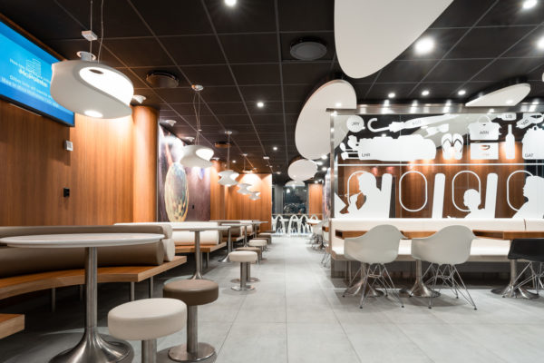 "McDonald's Arlanda Sky City  ROL Fredbergs would like to proudly present one of our latest projects that we have undertaken for McDonalds restaurants. McDonald's in Sky City within Arlanda airport, has opened a new system where the food is cooked to order and guests are then served at the tables. ""With our new ordering and cooking system and table service, we offer our guests an even better restaurant experience"", says restaurant owner Roland Edin. The new system is expected to reduce food waste by 20 percent. ""This concept looks very nice"", says ROL Fredbergs project manager Anders Gillström. We asked some of the customers their opinion on the restaurant and they agreed with Anders. ""This is a calm place to sit down to rest and refill with new energy"", says Kim, one of the early morning customers. ROL Fredbergs was given the go ahead to undertake the Project management services for a new construction of a McDonald's restaurant at Sky City. It is a very comprehensive project and its implementation took 9 weeks. Then followed 3 weeks of work on dismantling and restoring the room where McDonald's had the previous restaurant at the airport. The project included elements such as floating flooring, laying tiles, building walls, electrical work, painting, installing furnishings, installing alarms, coordinating kitchen construction and installing payment equipment and more. ""What was a bit special and challenging about this project was that there are two very sensitive tenants who are neighbours to the restaurant we built, a hotel and a bank. This meant that jobs that sound a lot like drilling or sawing could only be performed during specially agreed times of the day"", says Anders Gillström. We also had to make certain adjustments during the project because the conceptual drawing did not always match the fire protection equipment of the premises. But we made these adjustments in discussion with Per Widmark of McDonalds, during the project, says Anders. Thanks to a good dialogue, this did not create any problems. We would like to take the opportunity to thank Per for good cooperation and positive dialogue during the project. The restaurant has become a very nice dining environment and the new layout for both the kitchen and the staff room is working well. ""A tremendous improvement over the old restaurant"", says our Project Manager Anders. The new concept that has been built at Arlanda is called ""Airport"" to signify that it is used only at airports. https://rolfredbergs.com/"