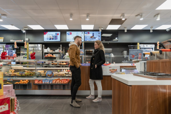 "OKQ8 - Quick To Go We are revisiting the forecourt store OKQ8 that is next to Landvetter airport in Gothenburg, where the new concept rollout called ""Quick To Go"" started in 2014. ""Since this first store delivery, ROL Fredbergs have completed about 240 store deliveries to OKQ8 – updating their stores to the Quick To Go concept"" – says Maria Sandberg, Project manager at ROL Fredbergs. ""I´m happy to find the store in such a good shape, after six years in use, it still looks very fresh"", says Maria. During the intervening years OKQ8 and ROL Fredbergs have developed many updates and additions to the Quick to Go concept.  We had the chance to talk to Tobias Lindmark, Store concept & Brand experience developer for OKQ8, and asked him about our co-operation. He commented that, ""ROL Fredbergs is an important part of our development work. ROL Fredbergs adds a high level of expertise and the knowledge we seek in a partner rather than a supplier. With its broad knowledge, ROL Fredbergs adds both business understanding and customer benefit within our forecourt store network"". What do you think is important in order to give the customer a positive experience in your store? ""With OKQ8's wide product range, it is important to always put the customer satisfaction first and always offer the best possible service, whether we talk about food, convenience, car hire, car wash or motorist products. Our customer service expertise guarantees the very best retail experience at our stations Tobias also said – ""We are constantly making improvements and updates. Credibility, customer satisfaction and sustainability are always on top of our mind. No concept is better than its followers, we are very proud to be able to present a complete retail chain with the same concept across all its stations in the near future. It proves the greatness of the brand OKQ8.""  Maria explains how the retail concept update process often looks like. ""The retail concept process normally starts with an idea from OKQ8, it can be a verbal description or sometimes a hand sketch. Then the ROL Fredbergs design team normally makes 3D visualization as the next step. Often there will be some minor adjustments from the initial interpretation. The following step is for ROL Fredbergs technical designers to make a design drawing. Often OKQ8 would like to see the solution prior to delivery, we then involve our prototyping department. With skilled and experienced factory workers, we can quickly produce the shop fixtures. In-house we can work with metal, wood, acrylic, composite materials, plus we have a partner network if we need other materials or solutions for the prototype. When the prototype is being validated there might be some new ideas or smaller updates. Then, when OKQ8 are happy with the result, we are all set for a large rollout of the new designed shopfitting concept solution.""  A fresh example of concept updates is the new developed ""Energizon"" which is being rolled out.  Maria has 18 years' experience working with concept development and project management at ROL Fredbergs.  Maria feels that the key to achieving client satisfaction includes a few factors to secure a successful concept rollout. ""Communication is always key. So many things can happen and an open communication with an honest dialogue is always the best. Then we need an understanding of what OKQ8 needs and the ability to convert the ideas into solutions. Often the timeline is short and there is a need for quick decision making, otherwise there is always a risk to jeopardize the project time plan.""   OKQ8 AB is one of Sweden's largest fuel companies. In 2012, OKQ8 AB in Sweden and Q8 Denmark A / S merged to form OKQ8 Scandinavia. The Swedish operations comprise about 740 stations. OKQ8 sells fuels such as gasoline, diesel, biogas, HVO100 and electric car charging. Many of OKQ8's 350 staffed service stations offer car wash, self-service laundry, car rental and garage, as well as car products and fast food."